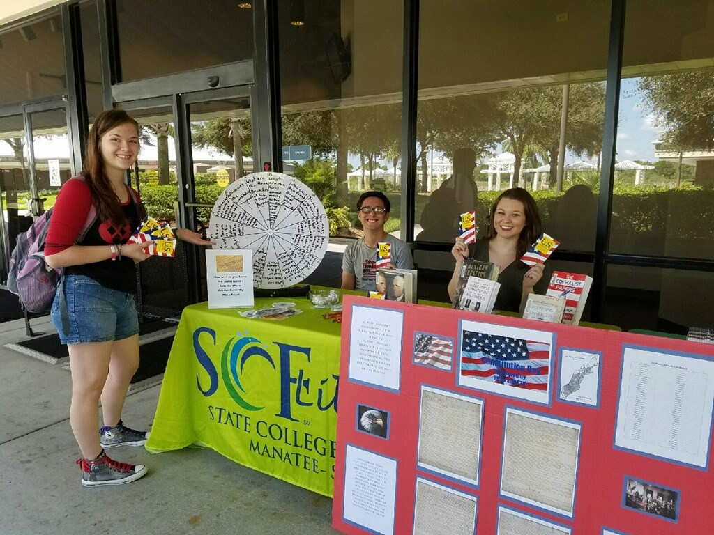 Members of the Student Government Association hand out pocket Constitutions for Constitution Day.