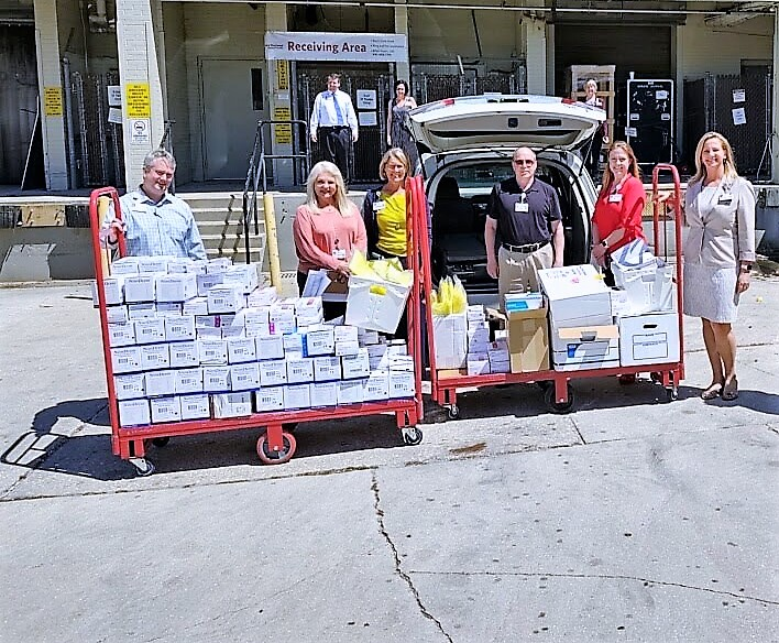 Venice Regional Bayfront Health staff receiving thousands of SCF PPE supplies.