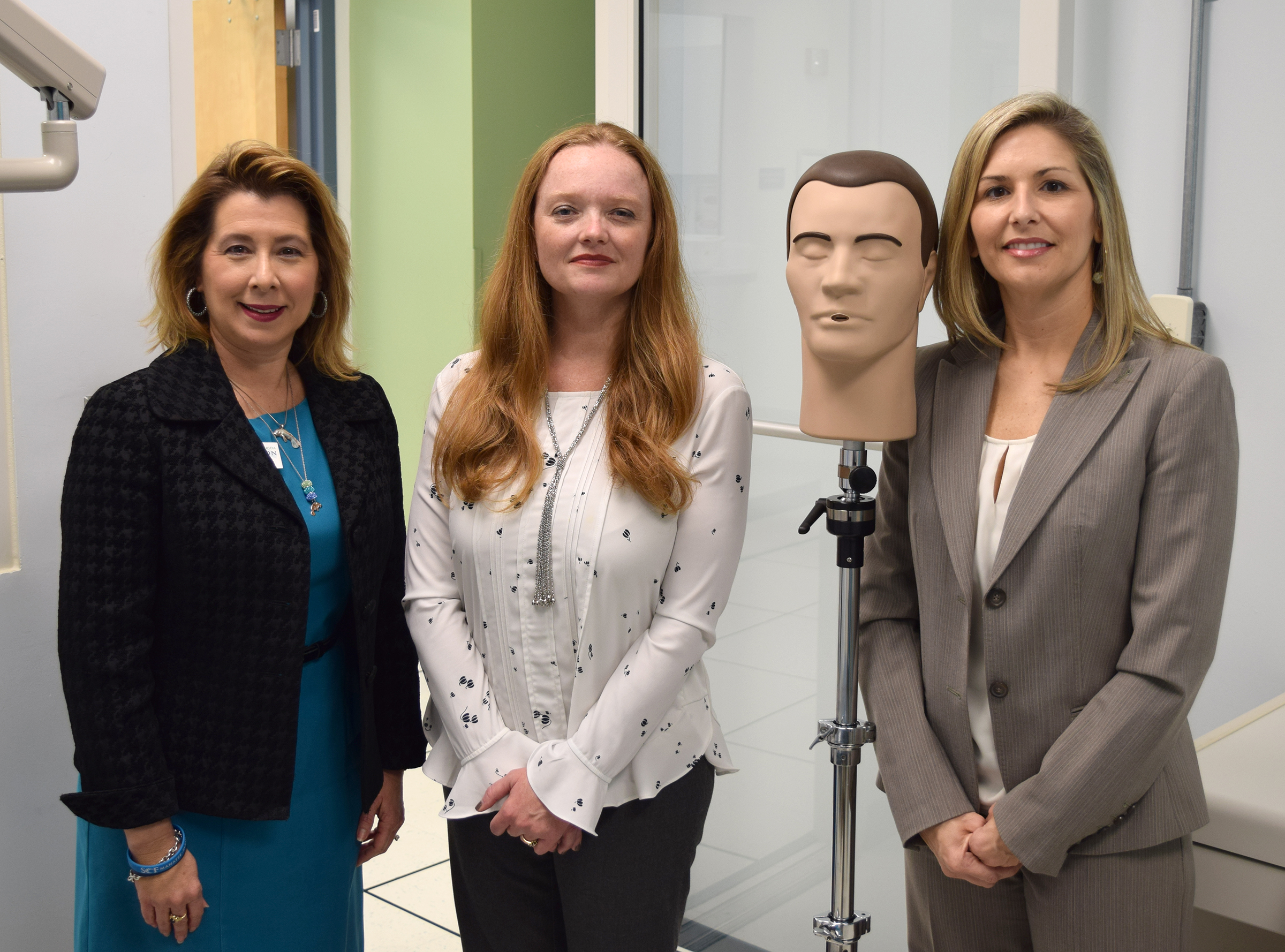 Cassandra Holmes, SCF Foundation Executive Director; Susie Bowie, Manatee Community Foundation-Executive Director; Dentsply DXTTR radiographic mannequin head; Kimberly Bastin, SCF Dental Hygiene-Program Chair.