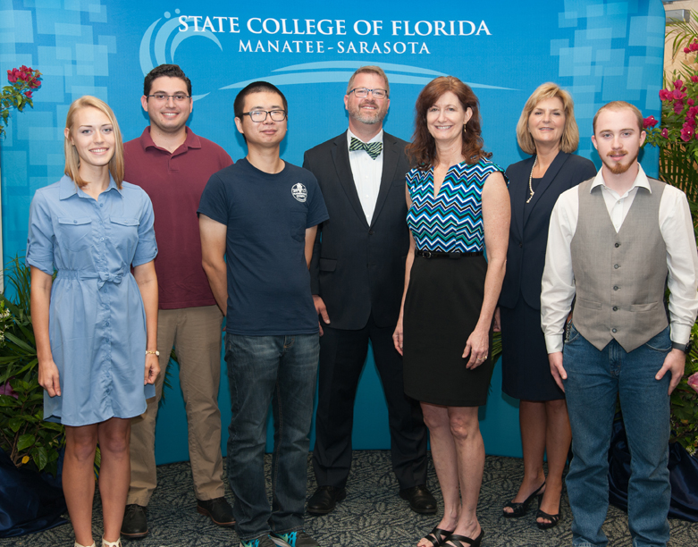 Stephenie Krum, Caio Richmond, Wentao Yuan, Ryan Hale, dean for Venice Campus, Catherine Panik, team coach, Dr. Carol Probstfeld, SCF president, and Tim Nail.