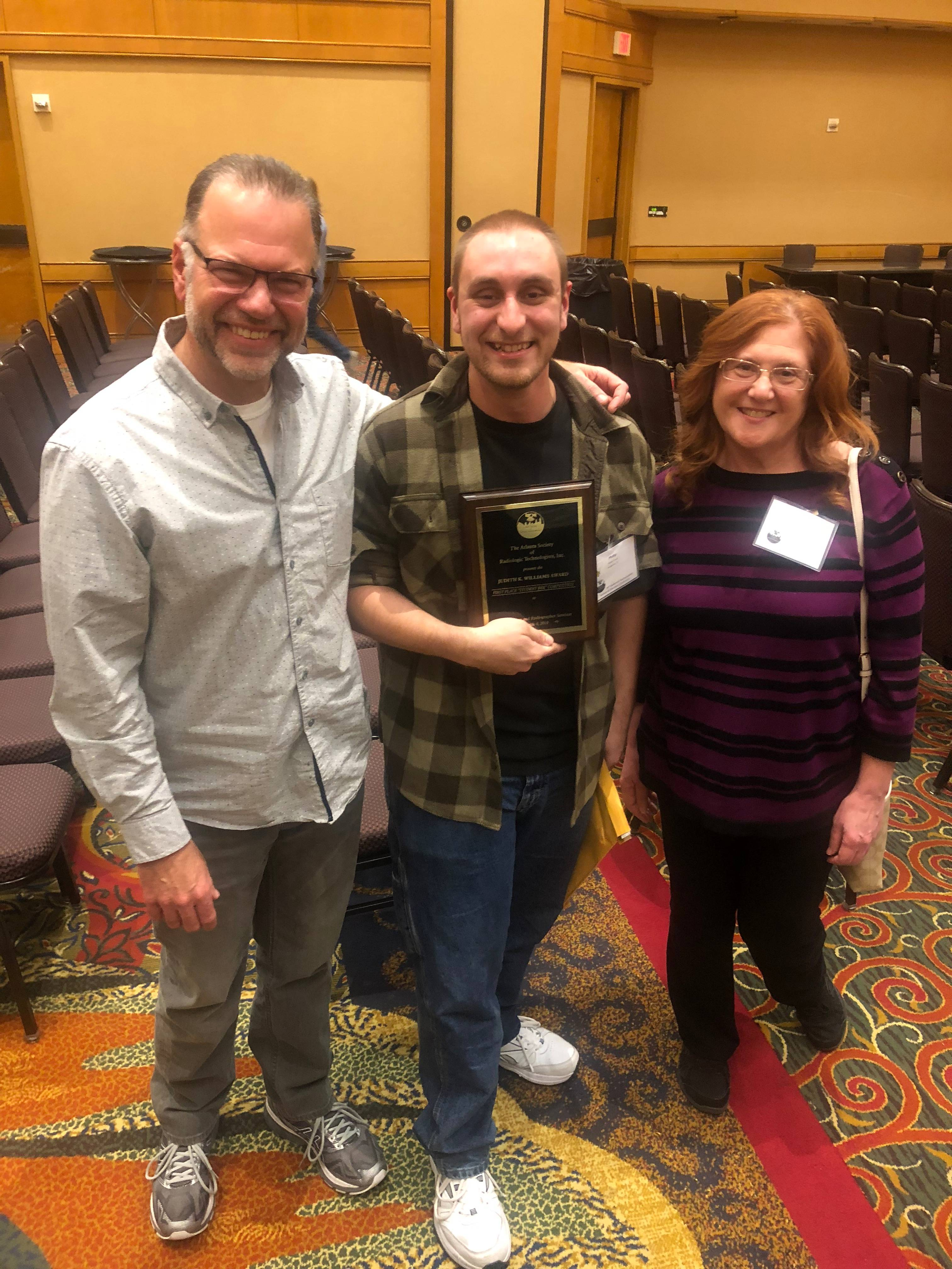 Patrick Patterson, radiography program manager; first-place winner and SCF student Phillip Cascio; Madelyn Micallef, radiography program clinical coordinator