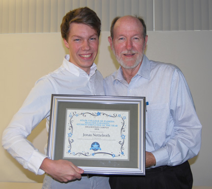 1. Jonas Nettelroth (l) received his Student Employee of the Year award for his work at SCFCS from Dr. Michael Mears, VP of Strategic Initiatives at SCF.