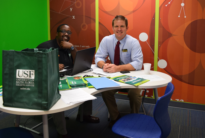 From Left Brandon Avery, Assistant Director of Admissions at USFSM and Andy Telatovich, Director of Admissions & Financial Aid at USFSM reviewed applications at the Collegiate School during Instant Decision Days.